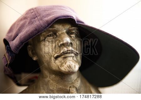 The funny bust of Lenin with cap