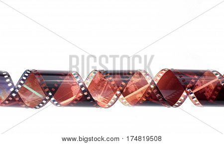 rolled camera film strip on white background