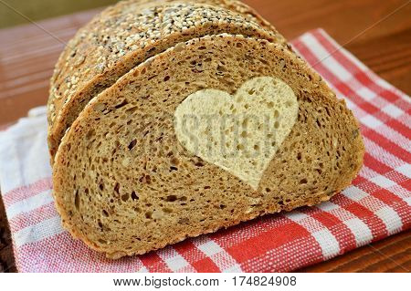 Whole wheat bread with a white bread heart