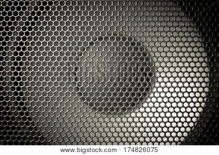 Detail shot of some round speakers. Speaker grill texture. Audio equipment.