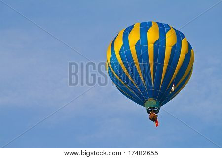 Hot Air Balloon In Cloudy Sky