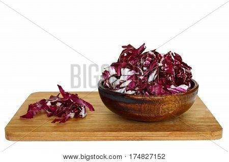 Radicchio in a wooden bowl  isolated on white background