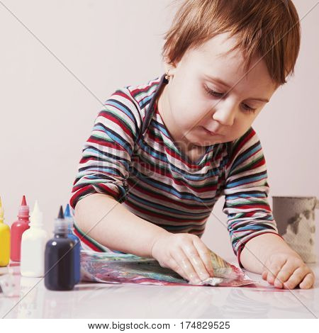 beautiful baby girl learning to draw (training development abilities)