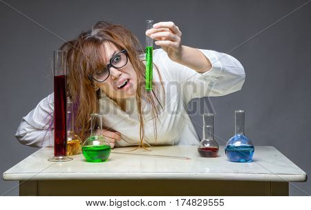 Very surprised shaggy scientist in lab on gray background