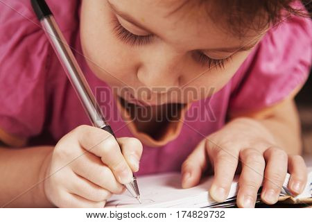 little baby girl learns to write (development training education)