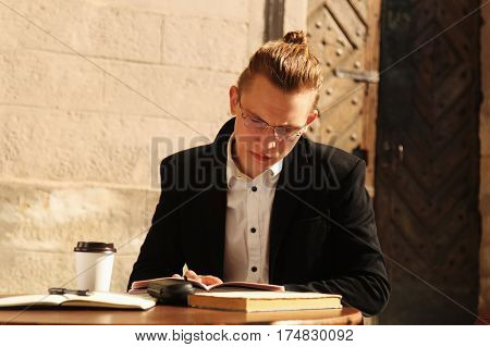 businessman sitting and working outdoors (Freelance freedom success development concept)