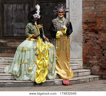 Venice, Italy - Apr 18, 2013: Couple In Carnival Costumes. Carnival Masks Is One Of The Most Famous
