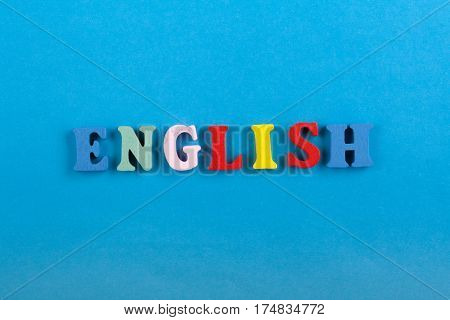 English word on blue background composed from colorful abc alphabet block wooden letters copy space for ad text. Learning english concept
