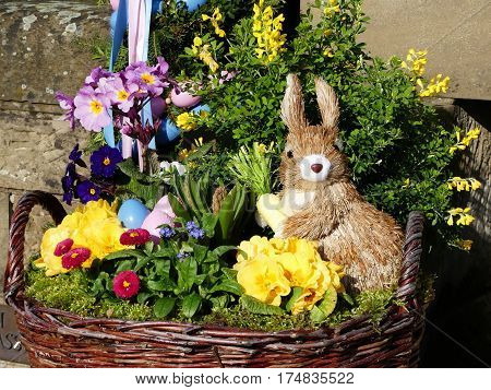 rabbit, colored eggs and flower are symbol of spring and easter