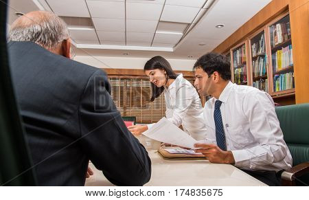 indian Business People Meeting, Corporate Communication or Teamwork Concept. indian businessmen in a conference room with paper and laptop