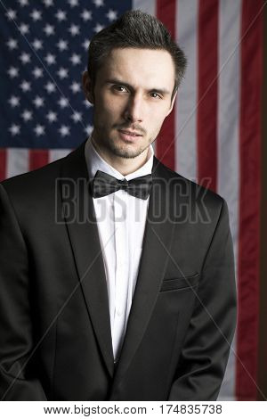 Portrait of a young congressman in the background of the American flag