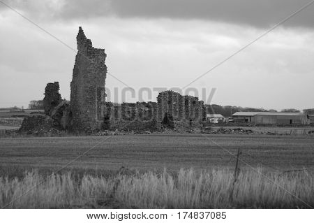 Black and white ruined castle at Inverallochy, Aberdeenshire