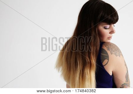 Woman With Tattoed Arm And Ombre Hair