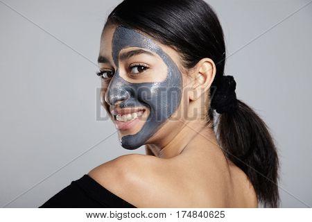 Youmg Woman With A Half Face Facial Mask