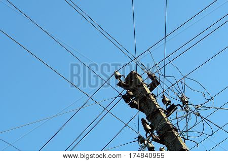 Intertwining of many electrical wires on pillar