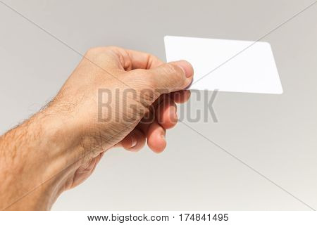 Male Hand With White Empty Card