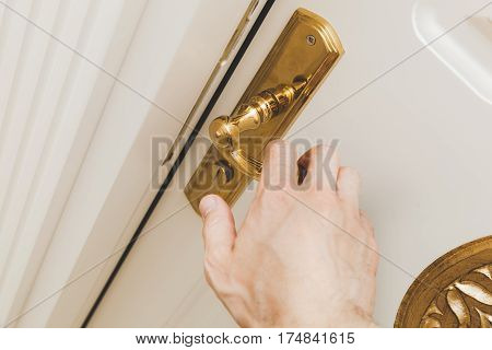 Male Hand Opens White Door