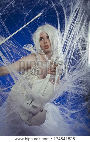 Symphony, Passion for classical music, woman dressed in white lace dress playing a violin