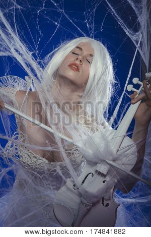 Violinist, Passion for classical music, woman dressed in white lace dress playing a violin
