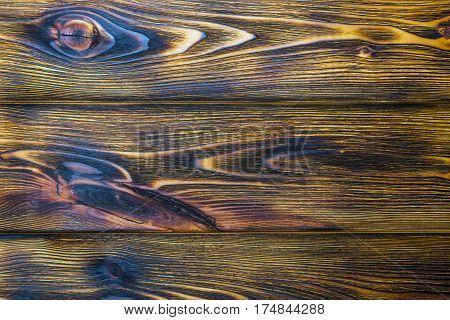 Burned wood board texture background, woodgrain texture