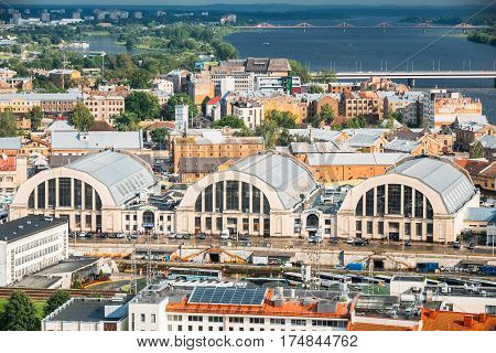 Riga, Latvia - July 1, 2016: Aerial Cityscape In Sunny Summer Evening. Top View Of Landmarks - Bus Station Riga International Coach Terminal And Riga Central Market
