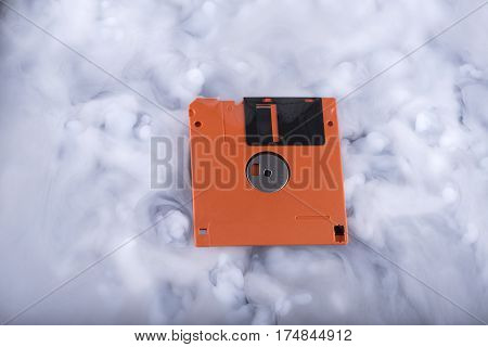 Floppy disk in a clouds. Conceptual image