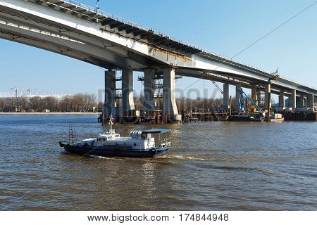 Construction of a bridge across the river. Stock image.