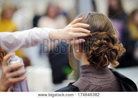 Young Woman Getting Her Hair Done Before Party