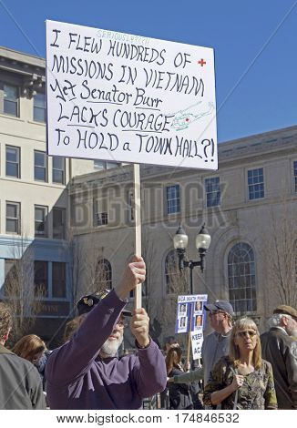 Asheville North Carolina USA - February 25 2017: Male American Vietnam Veteran holds a sign saying