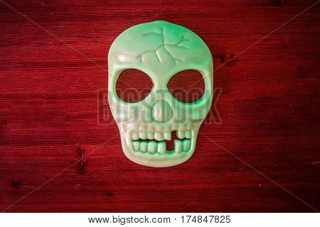decoration phosphoric scull on red wood background