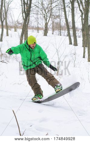 Snowboarder Coming Down The Hill On A Snowboard.