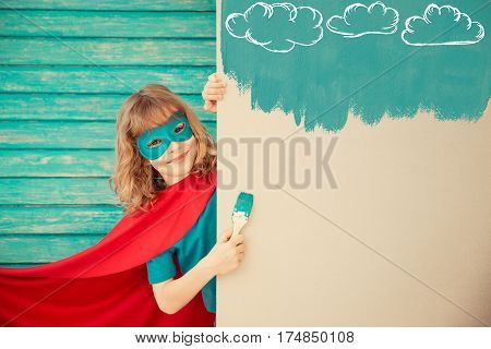 Superhero Child Playing Indoor