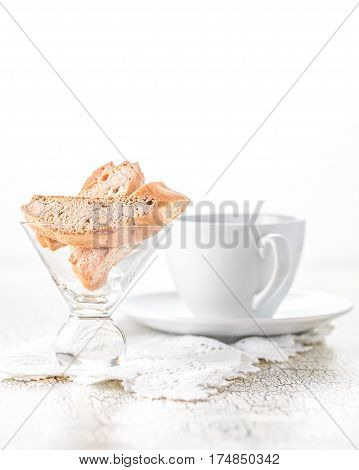 Delicious almond biscotti served with a cup of coffee.