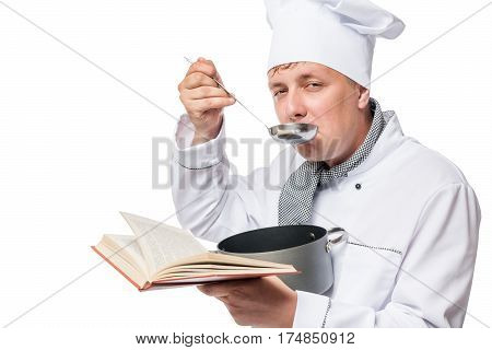 A Man In A Suit Chefs With A Pot Of Soup And With Ladle