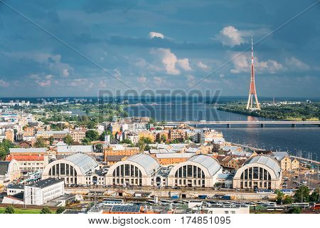 Riga, Latvia - July 1, 2016: Riga, Latvia. Aerial Cityscape In Sunny Summer Evening. Top View Of Landmarks - Bus Station Riga International Coach Terminal, Riga Central Market And Television Tower