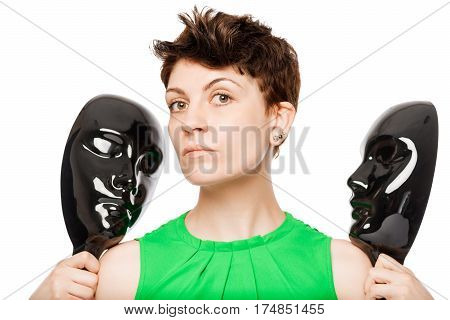 Brunette Holding Two Black Mask On A White Background Isolated