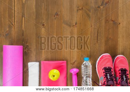Dark Wood Floors And Facilities For Sports At The Bottom Of The Frame