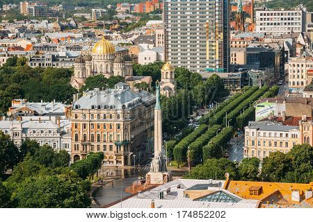 Riga, Latvia - July 1, 2016: Riga Cityscape In Sunny Summer Day. Top View Of Famous Landmarks - Riga Nativity Of Christ Cathedral, Memorial Freedom Monument And Freedom Boulevard Street.