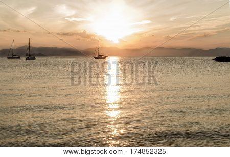 sunrise on the blue sea island Aigina Greece