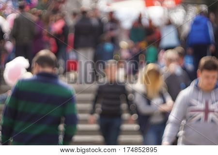 Out Of Focus, Unrecognizable People Walking In The Park