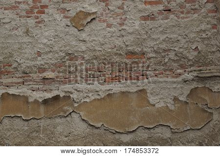Part of old brick wall and painted plaster