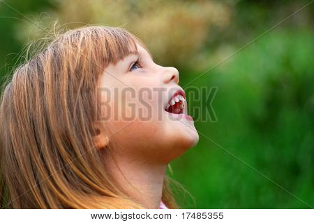 Portrait of a little cute laughing girl