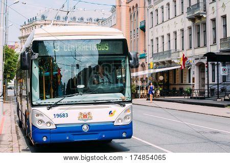 Riga, Latvia - July 1, 2016: Public trolleybus driven by a female driver on summer street in Riga, Latvia