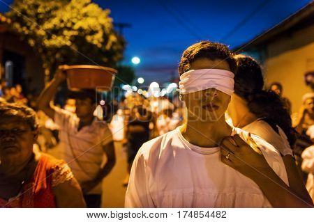 Leon Nicaragua - April 15 2014: Blindfolded man in a procession in the streets of the city of Leon in Nicaragua during the Easter celebrations