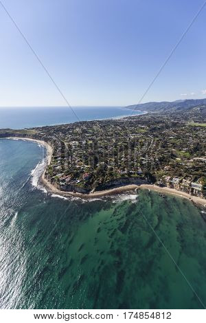 Aerial view of Point Dume and clear Pacific Ocean water in Malibu, California.