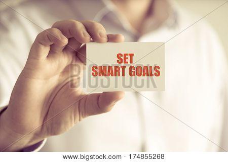 Businessman Holding Set Smart Goals Message Card