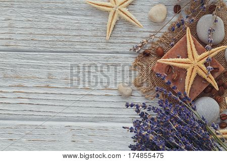 Natural handmade soaps with sea salt coffee beans sea star and dried lavender flowers. Bodycare and spa concept.