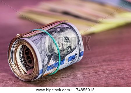 Us Dollar Roll On A Wooden Table