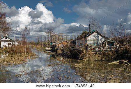 Spring flood in old fisherman's village, overcast