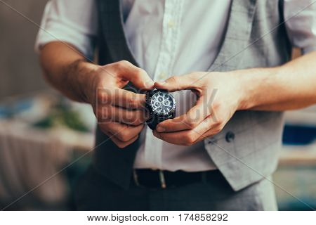 successful man in suit with watch indoor